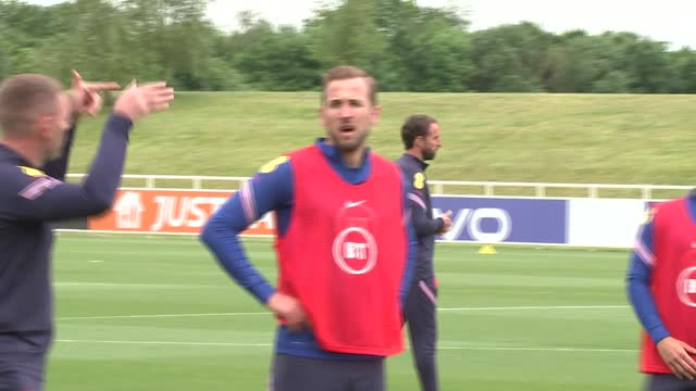 england team training; england: staffordshire: st george's park: ext gvs england team training - players doing exercises and drills, including close... - mountain stock videos & royalty-free footage