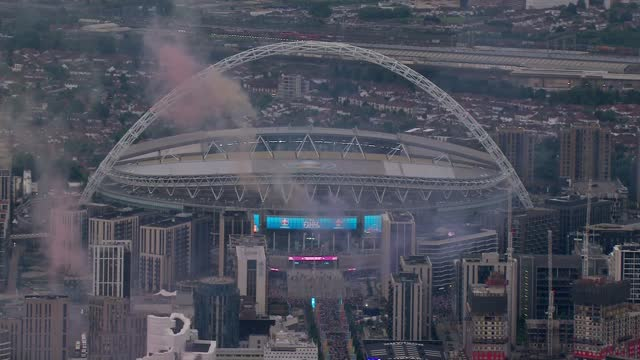 england v italy final: aerials over trafalgar square and wembley stadium; england: london: wembley: ext air view wembley stadium with fans outside... - smoke physical structure stock videos & royalty-free footage