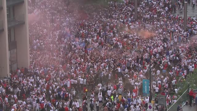england v italy final build-up; england: london: wembley stadium: ext shot above the crowds of fans gathering outside the stadium before euro 2020... - smoke physical structure stock videos & royalty-free footage