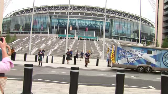 england v scotland: 20,000 scottish fans expected to descend on london; england: london: wembley stadium: ext gvs man playing bagpipes two men with... - men stock videos & royalty-free footage