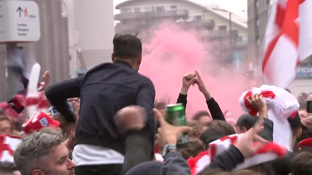 fans outside wembley stadium ahead of england v germany match; england: london: wembley: ext **warning bad language** england football fans on... - smoke physical structure stock videos & royalty-free footage