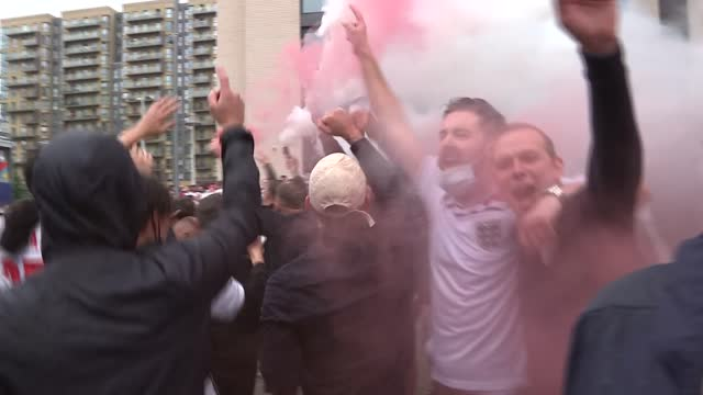 fans outside wembley stadium ahead of england v germany match; england: london: wembley: ext **warning bad language** various of crowd of england... - smoke physical structure stock videos & royalty-free footage