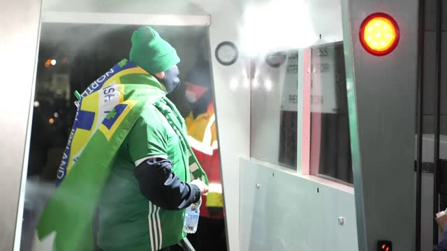 scotland qualify but northern ireland fall short; northern ireland: belfast: windsor park: ext / night northern ireland fans arriving at windsor park... - fan enthusiast stock videos & royalty-free footage