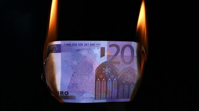 euro banknote burning - burning stock videos & royalty-free footage