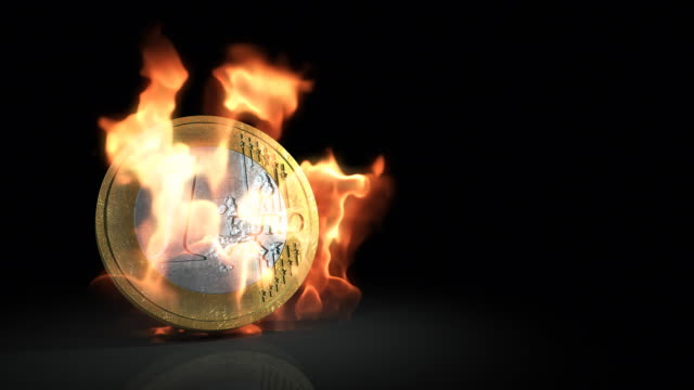 euro coin in flames - european union coin stock videos & royalty-free footage