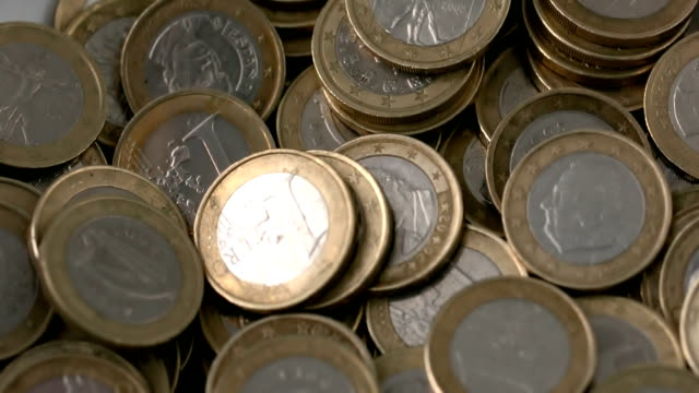 euro coins falling on pile - money makes the world go around stock videos and b-roll footage