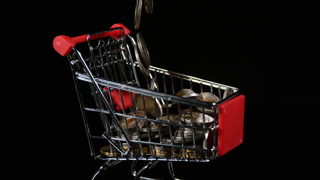 euro coins in trolley rolling against black background, slow motion, 4k - scale stock videos & royalty-free footage