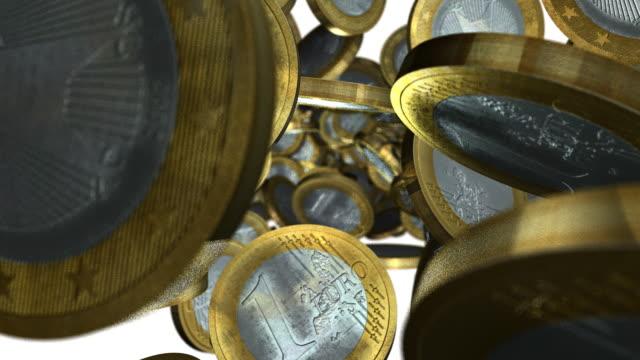 euro coins tumbling towards view with white background - european union coin stock videos & royalty-free footage