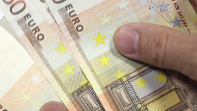 euro - counting money. close up - zahl stock videos & royalty-free footage