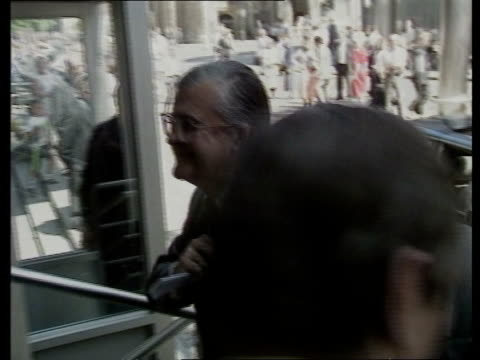 mep's thatcher ext london ec3 1 lime st lloyd's bldg kenneth baker mp pauses to donate to charity from flag seller pick up lapel flag comments it's... - mep stock-videos und b-roll-filmmaterial