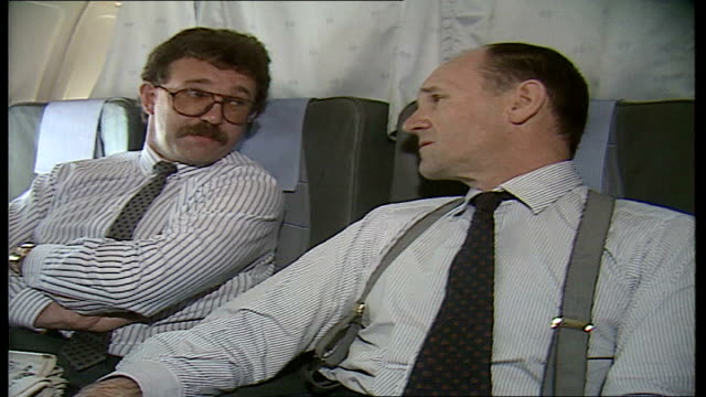 stockvideo's en b-roll-footage met 30 euro mp seated in plane reading paper with article 'how can we control our own destiny in europe' pilots in cockpit dials mep christopher prout... - cockpit