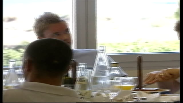 stockvideo's en b-roll-footage met euro preparations / ulrika jonsson row spain almansa int northern ireland football players sitting in dining room eating sammy mcilroy interviewed... - ulrika jonsson