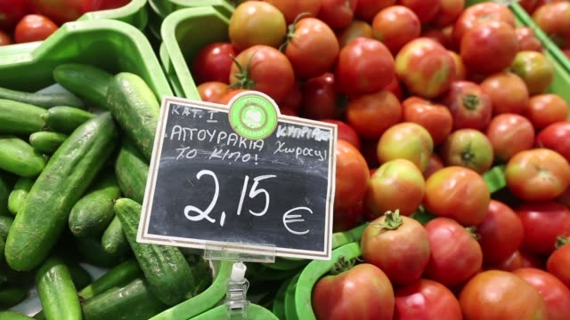 a euro price sign sits on a display of fresh peppers inside a carrefour sa supermarket part of the marinopoulos group at the mall of cyprus in... - キプロス ニコシア点の映像素材/bロール
