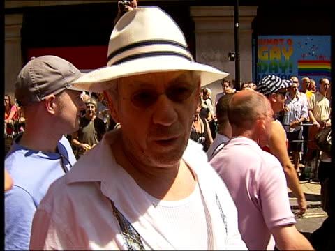 euro pride parade through central london: sir ian mckellen interview; sir ian mckellen marching along among euro pride participants, interview sot -... - ian mckellen stock videos & royalty-free footage