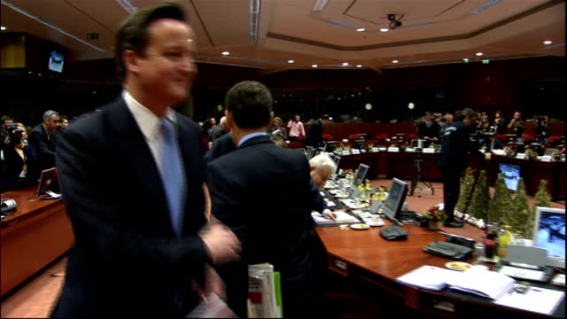 reaction to David Cameron's veto to treaty changes 9122011 BELGIUM Brussels INT David CameronMP brushes past Nicolas Sarkozy at the EU summit they...