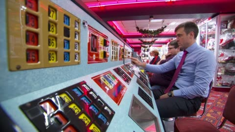 euromillions lottery jackpot still unclaimed by skegness winner; uk, lincolnshire, skegness; people playing bingo, traffic along, people shopping,... - smith tower stock-videos und b-roll-filmmaterial