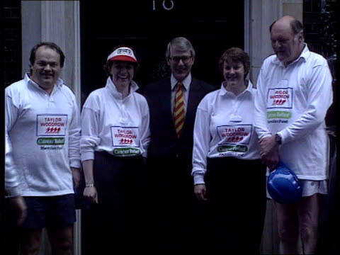 Europe and the Conservative party Downing St MS TugofWar in progress PAN LR as PM John Major watches in b/g MS Major standing with tuggers for...