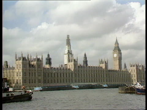 conservative party gv palace of westminster as steeple under scaffolding gv palace of westminster as westminster bridge in f/g cms windows pan lr - steeple stock videos & royalty-free footage