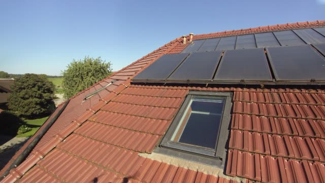 Europe, Germany, Bavaria, Aerial View Of Solar Panels On Farmhouse Roof With Water Heating Panels (Beneath)