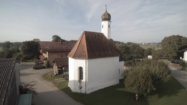 europe, germany, bavaria, aerial view of tiny german church on farm - onion dome stock videos and b-roll footage
