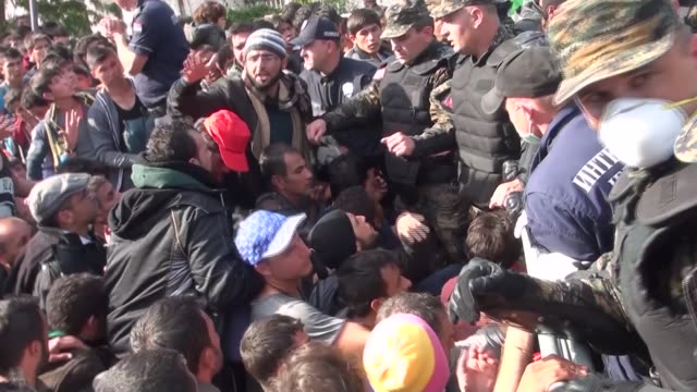 7000 refugees arrive in serbia from macedonia serbia presevo ext bvs serbian police trying to hold back mass of refugees at border with macedonia red... - emigration and immigration stock videos & royalty-free footage