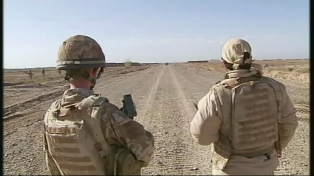 stockvideo's en b-roll-footage met afghans who helped british forces facing eviction from 'jungle' camp t12031001 / tx 1232010 afghanistan helmand province british soldiers in road... - vertaling