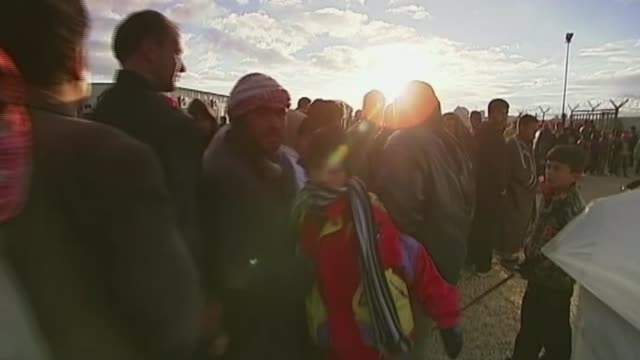 Aylan Kurdi buried in Kobani as father appeals for countries to help JORDAN People queueing in refugee camp TRACK People trying to push through gates...