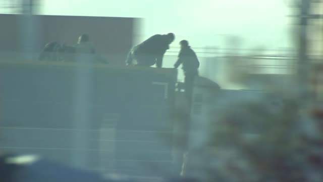 Brothers separated by the English Channel T26111511 / FRANCE Calais EXT Refugees and migrants riding atop lorry as along as trying to get into the UK...
