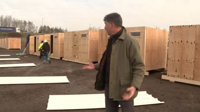 europe migrant crisis: calais migrant camp given legal go-ahead to be cleared; calais: ext french police officers next to van migrants along in front... - construction vehicle stock videos & royalty-free footage