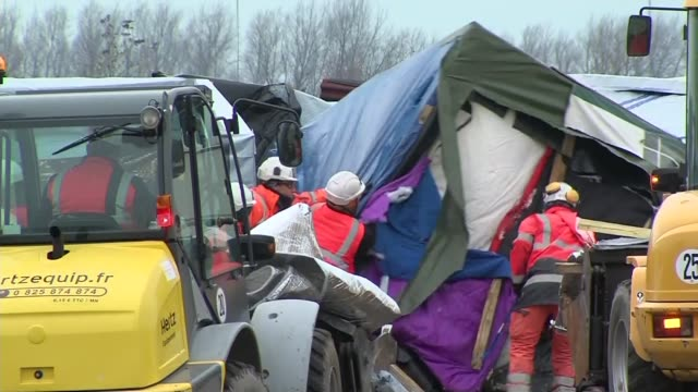 calais police continue to clear 'jungle' migrant camp france calais ext french police with truncheons climbing onto roof of hut to arrest migrants... - blanket background stock videos & royalty-free footage
