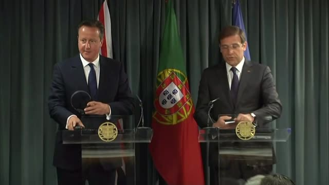 Cameron promises more help PORTUGAL Lisbon EXT British Prime Minister David Cameron MP from car and greeted by Prime Minister Pedro Passos Coelho...
