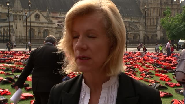 europe migrant crisis: campaigners lay out thousands of refugee lifejackets in parliament square; juliet stevenson interview sot - juliet stevenson stock videos & royalty-free footage