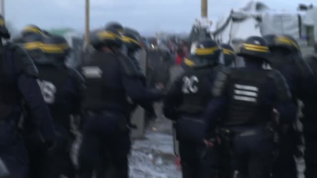 Clashes with refugee and migrants as police begin to clear the Jungle camp FRANCE Calais EXT Fire burning in the Jungle refugee camp PULL OUT as riot...