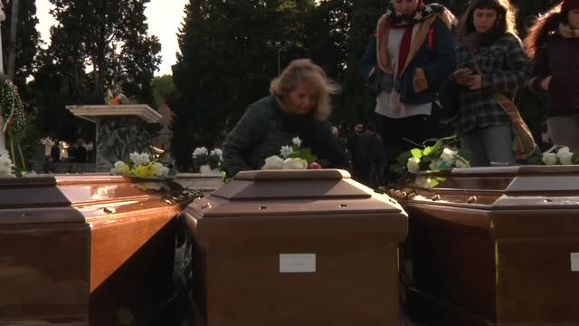 europe migrant crisis: funeral held for nigerian women who died at sea; italy: salerno: ext close shots of coffins of 26 nigerian women laid out at... - coffin stock videos & royalty-free footage
