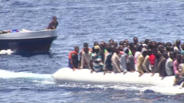 House of Lords criticizes response to crisis in Mediterranean T04071712 / TX EXT Various shots boats filled with refugees / migrants