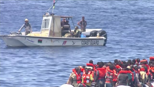 house of lords criticizes response to crisis in mediterranean t04071712 / tx libya sabratah **secretly filmed footage** migrant boats at coast man... - mittelmeer stock-videos und b-roll-filmmaterial