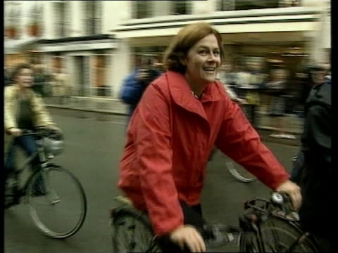 europe no car day; itn france: paris: ext almost deserted street people riding bicycles along street police directing traffic vox pops sot belgium:... - brussels capital region stock videos & royalty-free footage