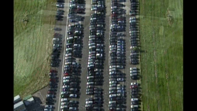 concern over jobs at vauxhall; t09100804 cambridgeshire: air views of disused airfield where crates and vehicles are lined up on tarmac merseyside:... - 英チェシャー州点の映像素材/bロール