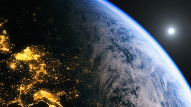 Europe seen from space with the sun over the horizon. In 4 k