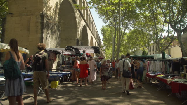 europe street market under saint clement aqueduct at montpellier - french culture stock videos & royalty-free footage