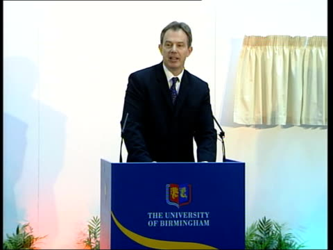 Birmingham Tony Blair MP standing on podium at opening of European Research Institute Audience watching MS Blair unveiling plaque at opening ceremony...