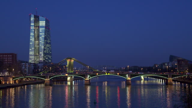 european central bank building illuminated with main river at dusk twilight. - frankfurt main stock videos and b-roll footage