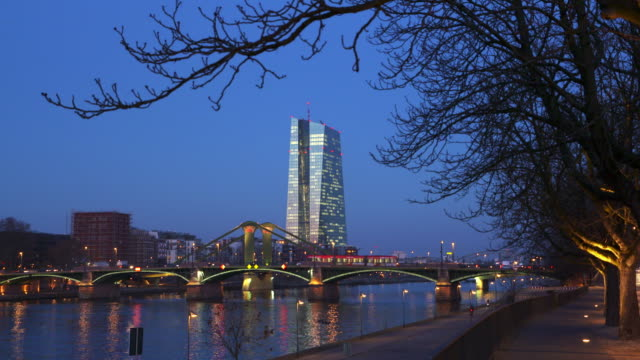 european central bank building with main river at dusk. - frankfurt main stock videos and b-roll footage