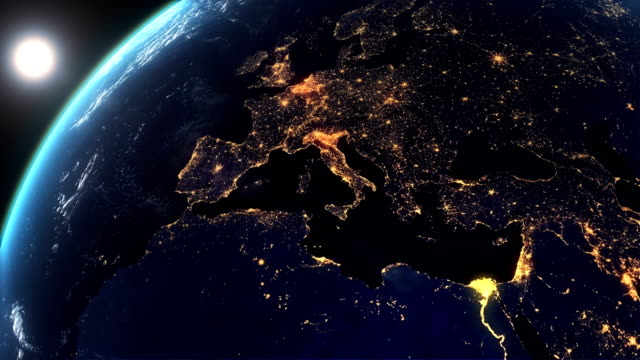 vídeos de stock e filmes b-roll de european city lights from the space and sunrise - city