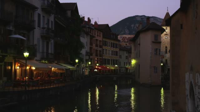 European cityscape of a river, a bridge and buildings