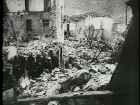 european civilians cry in despair at the rubble around them after war has destroyed their homes. - concentration camp stock videos & royalty-free footage