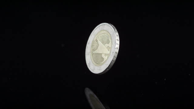 european coin rotates in the air - european union coin stock videos & royalty-free footage