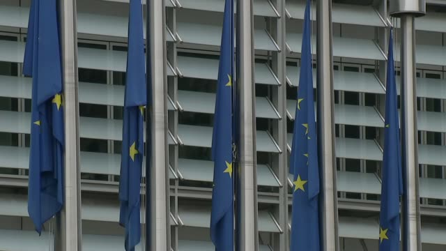 European Commission and European Council buildings general views BELGIUM Brussels EXT GVs Berlaymont building / EU flags on flagpoles / Berlaymont...