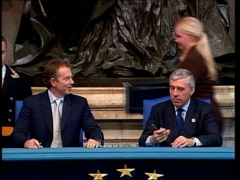 aftermath of netherlands referendum lib italy rome int blair and foreign secretary jack straw sitting at desk after signing constitution silvio... - バーティ アハーン点の映像素材/bロール