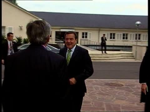 vídeos de stock, filmes e b-roll de aftermath of netherlands referendum luxembourg gerhard schroeder and jeanclaude juncker embrace each other then walk towards camera track schroeder... - embrace